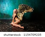 beautiful young model wearing ...   Shutterstock . vector #1154709235