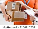 a person wearing an orange t...   Shutterstock . vector #1154715958