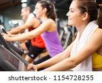 smiling woman doing indoor... | Shutterstock . vector #1154728255