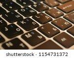 dusty black keyboard  laptop | Shutterstock . vector #1154731372