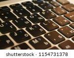 dusty black keyboard  laptop | Shutterstock . vector #1154731378