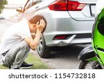asian man upset driver feeling... | Shutterstock . vector #1154732818