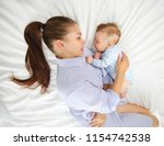 portrait of a young mother and... | Shutterstock . vector #1154742538