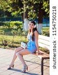 cheerful woman in blue romper... | Shutterstock . vector #1154750218