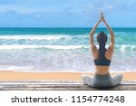 young woman practicing yoga in... | Shutterstock . vector #1154774248