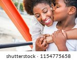 happy african mother having fun ... | Shutterstock . vector #1154775658