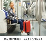 portrait of young woman tourist ... | Shutterstock . vector #1154778385