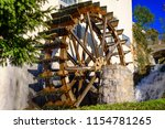 Big Water Wooden Wheel Near Th...