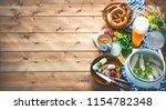 bavarian sausages with pretzels ... | Shutterstock . vector #1154782348