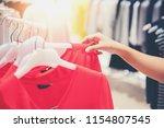 hand of customer choosing...   Shutterstock . vector #1154807545