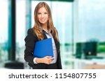 smiling secretary portrait | Shutterstock . vector #1154807755