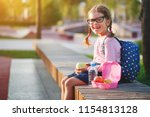 schoolgirl child eating lunch... | Shutterstock . vector #1154813128