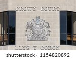 Small photo of Swansea, Wales, UK, June 30, 2018 : Swansea Crown Court sign in St Helen's Road which is the highest court of first instance in criminal case