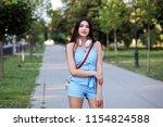 fashionista brunette woman in... | Shutterstock . vector #1154824588