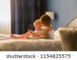 two sibling children  baby boy... | Shutterstock . vector #1154825575