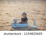 cute baby child  sweet boy ...   Shutterstock . vector #1154825605