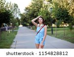 beautiful fashionable woman is... | Shutterstock . vector #1154828812