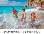 mother father and children are... | Shutterstock . vector #1154844478