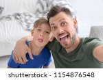 little boy with his dad taking... | Shutterstock . vector #1154876548
