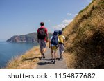 father and two boys  family... | Shutterstock . vector #1154877682