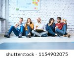 group of young startup... | Shutterstock . vector #1154902075