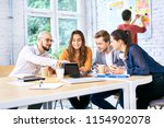creative workers sitting at...   Shutterstock . vector #1154902078