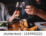 glasses of red wine with food... | Shutterstock . vector #1154902222