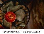 sauna stones   hot stones for... | Shutterstock . vector #1154908315