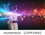 new technologies  a boy uses a... | Shutterstock . vector #1154914642