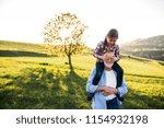 a senior grandfather giving a... | Shutterstock . vector #1154932198