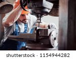 experienced operator in a hard...   Shutterstock . vector #1154944282