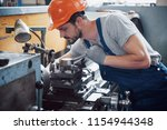 experienced operator in a hard... | Shutterstock . vector #1154944348