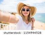 beautiful girl in sunglasses... | Shutterstock . vector #1154944528