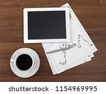 finance table on a wooden table ... | Shutterstock . vector #1154969995