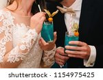 the bride and groom holding a... | Shutterstock . vector #1154975425