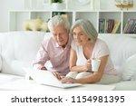 portrait of happy senior couple ... | Shutterstock . vector #1154981395