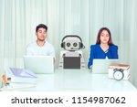 skeptical corporate employees... | Shutterstock . vector #1154987062