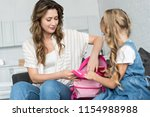 Mother And Daughter Packing...
