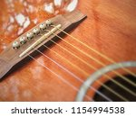 steel string acoustic guitar... | Shutterstock . vector #1154994538