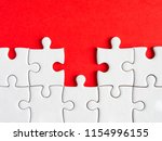 missing white jigsaw puzzle on...   Shutterstock . vector #1154996155