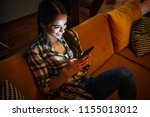 attractive woman sitting at... | Shutterstock . vector #1155013012
