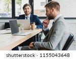 handsome young businessmen in... | Shutterstock . vector #1155043648