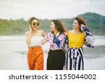 three beautiful girls travel... | Shutterstock . vector #1155044002