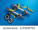 dumbells with yellow measuring... | Shutterstock . vector #1155049702