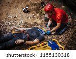 search and rescue team helping... | Shutterstock . vector #1155130318