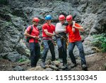 search and rescue team helping... | Shutterstock . vector #1155130345