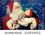 Santa Claus Sitting With A...