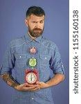 man with beard hold alarm clock.... | Shutterstock . vector #1155160138