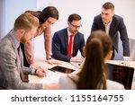 business people brainstorming... | Shutterstock . vector #1155164755