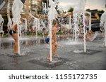 children play in the fountain. ... | Shutterstock . vector #1155172735